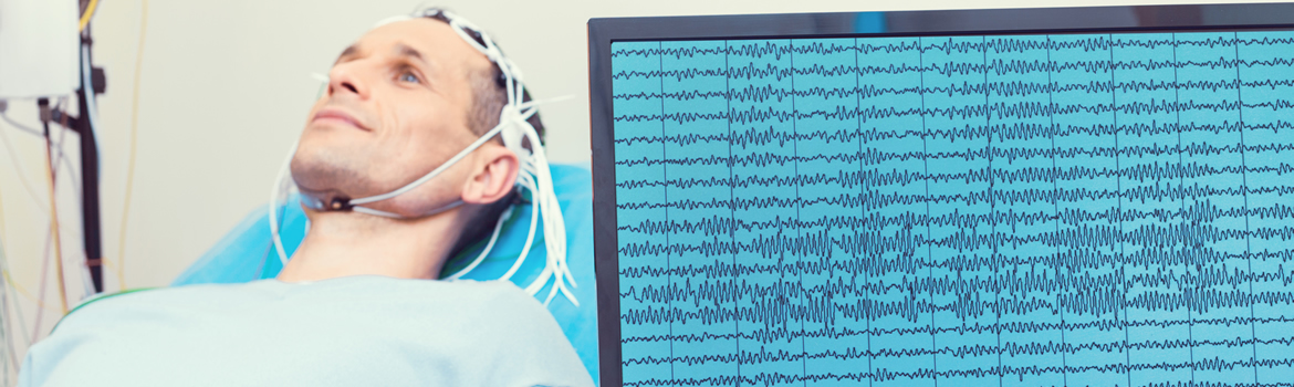 Man living with Epilepsy undergoing a hospital test